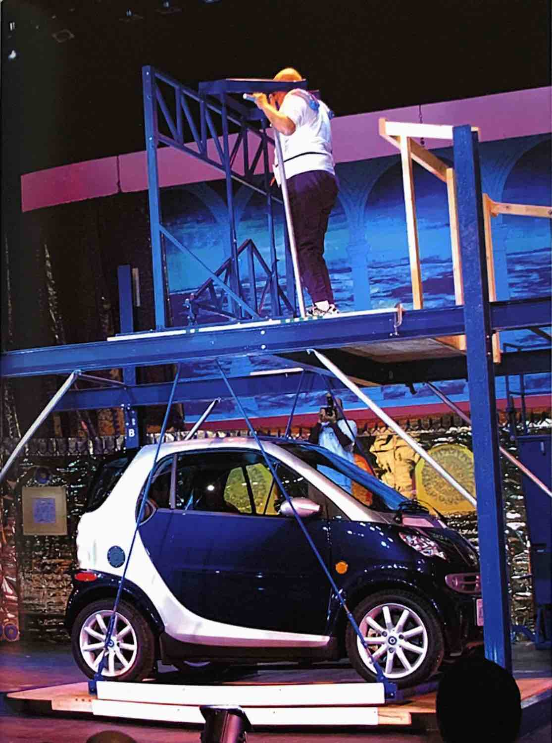 <b> Smart Car lift </b>- At the culmination of a public weightlifting exhibition in New York (November 2004), Sri Chinmoy lifted a car weighing the total of 2,229 lbs (1,012 kg) using a standing calf raise machine with a suspended platform beneath.